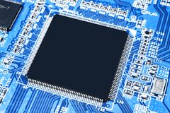 Macro shot of a Circuitboard with resistors microchips and electronic components. Computer hardware technology. Integrated communi stock images