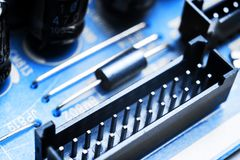 Macro shot of a Circuitboard with resistors microchips and electronic components. Computer hardware technology. Integrated communi royalty free stock images