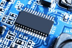 Macro shot of a Circuitboard with resistors microchips and electronic components. Computer hardware technology. Integrated communi royalty free stock photo
