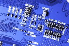 Macro shot of a Circuitboard with resistors microchips and electronic components. Computer hardware technology. Integrated communi royalty free stock photos