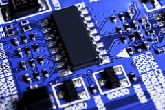 Macro shot of a Circuitboard with resistors microchips and electronic components. Computer hardware technology. Integrated communi stock photo
