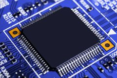 Macro shot of a Circuitboard with resistors microchips and electronic components. Computer hardware technology. Integrated communi royalty free stock image
