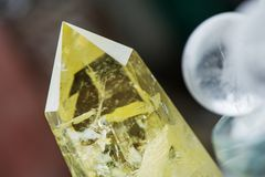 Macro shot of citrine stone and crystal balls on colorful background stock photo