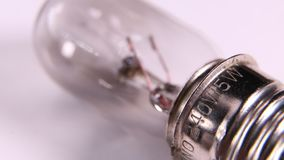 Old tungsten bulb with filament. Macro shot of a classic tungsten bulb and filament stock video footage
