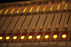 Macro shot close up of sound mixing board in recording record studio Stock Image