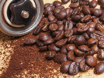 Macro shot of coffee beans and metal manual grinder with coffee Royalty Free Stock Photos