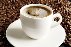 Macro shot of coffee cup with foam at breakfast Royalty Free Stock Photo
