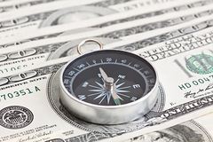 Macro shot of compass with 100 dollar Stock Photo