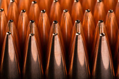 Macro shot of copper bullets that are in many rows Royalty Free Stock Images
