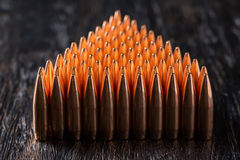 Macro shot of copper bullets that are in many rows Stock Images