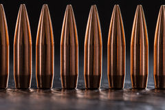 Macro shot of copper bullets that are in one row Royalty Free Stock Images
