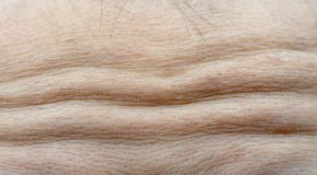 Macro shot detail of forehead wrinkles from emotional expression stock photos