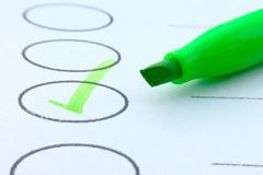 Macro shot of drawing green check mark in checklist box-go green idea. Macro shot of drawing green check mark in checklist box Royalty Free Stock Images