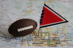 Arizona Cardinals. Macro shot of a flag and football placed on Glendale, Arizona in a map royalty free stock images