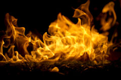 Fire Pit Macro Horizontal. A macro shot of a flame emitting from a glass fire pit Royalty Free Stock Photos