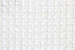 Macro shot fragment embroidery pattern white thread handmade embroidery, pattern in cross-stitch style on white fabric Royalty Free Stock Photography