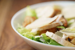 Macro shot of fresh homemade caesar salad with chicken Stock Image