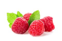 Macro shot of fresh raspberries with leaves isolated on white background. Macro shot of fresh raspberries with leaves isolated on white background Royalty Free Stock Images