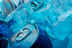Ice cubes and cans Royalty Free Stock Photo