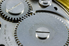 Macro shot of gears in a old wrist watch.  Royalty Free Stock Images