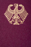 German Coat of Arms. A macro shot of the German coat of arms printed on a German passport cover Stock Photography