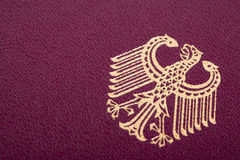 German Coat of Arms. A macro shot of the German coat of arms printed on a German passport cover Stock Photo