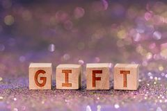Gift word on wooden cubes stock images