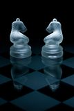 Macro shot of glass chess pieces Royalty Free Stock Images