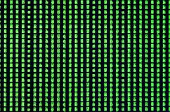 Macro shot of a glitch on the monitor of an office computer. The concept of introducing a virus into a personal data keeper. Strea. M of random green symbols on royalty free stock image