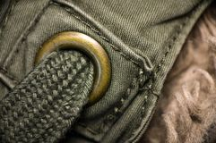 Macro shot of green textured garment. Macro shot of green textured army garment Stock Image