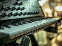 Macro shot hand playing on the synthesizer piano keys stock photos