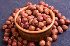 Macro shot of hazelnuts. In bowl . On stone background Stock Photo