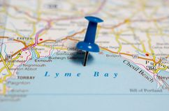 Lyme Bay on map. Macro shot of Lyme Bay on map with push pin Royalty Free Stock Photos
