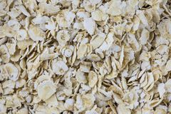 Oat flakes background or texture. Macro shot is made by means of stacking technology Stock Images