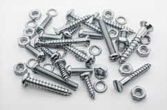 A Macro Shot of A Medium Collection Of Iron Screws, Nuts and Lockwashers Stock Photos
