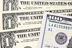 Macro shot of a new 100 dollar bill and one dollar Royalty Free Stock Image
