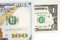 Macro shot of a new 100 dollar bill and one dollar. Isolate on white background Stock Photo