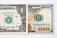 Macro shot of a new 100 dollar bill and one dollar. Isolate on white background Royalty Free Stock Image