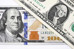 Macro shot of a new 100 dollar bill and one dollar. Isolate on white background Stock Photography