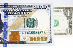 Macro shot of a new 100 dollar bill and one dollar. Isolate on white background Royalty Free Stock Photos
