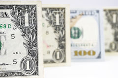 Macro shot of a new 100 dollar bill and one dollar. Isolate on white background Stock Image