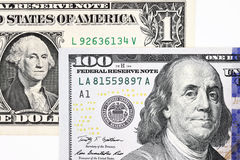 Macro shot of a new 100 dollar bill and one dollar Stock Photos