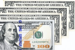 Macro shot of a new 100 dollar bill and one dollar Stock Images