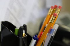 Macro shot of office supplies pens and pencils at a desk. This is a close up macro shot of pens and pencils at a desk in an office work related environment Royalty Free Stock Photo