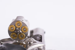 Macro shot of an open revolver loaded with bullets. Revolver and bullets on white background Stock Photography