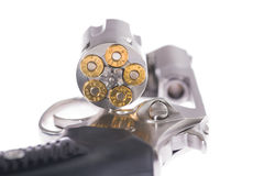 Macro shot of an open revolver loaded with bullets. Revolver and bullets on white background Stock Photo