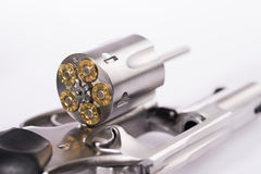 Macro shot of an open revolver loaded with bullets. Revolver and bullets on white background Stock Images