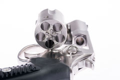 Macro shot of an open revolver. Macro shot revolver on white background Royalty Free Stock Photo