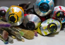 Macro shot of paint and brushes. Macro shot of acrylic paint and brushes Royalty Free Stock Photo