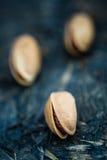 Macro Shot of Pistachio Nuts on Blue Background Stock Image